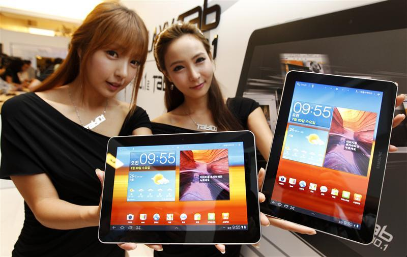 Models hold Samsung Electronics' new tablet 'Galaxy Tab 10.1' during its launch ceremony at the firm's headquarters in Seoul